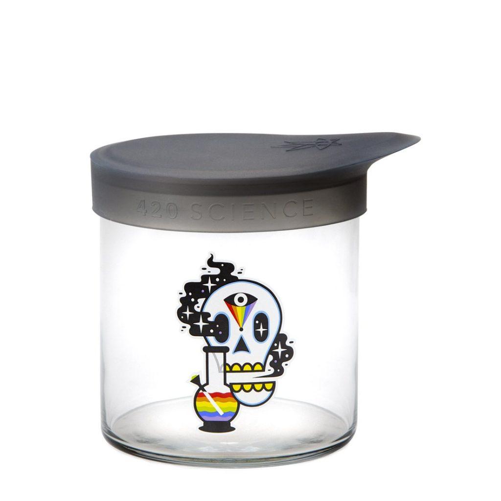 Glass stash jar with skull design.