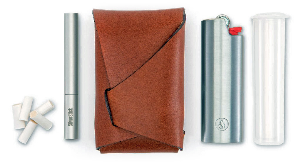 This leather smoking pouch folds up like an origami envelope to create a luxurious and stylish portable dugout kit that holds a one-hitter pipe, lighter and more.